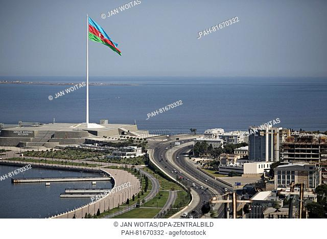 A giant Azerbaijanian flag (35x70 metres big) waves on the square of the state flag on a 162-metre-long flagpole in Baku, Azerbaijan, 30 June 2016
