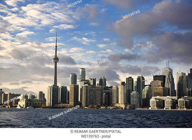 Evening sunlight on Toronto skyline highrise towers from Ferry in harbour