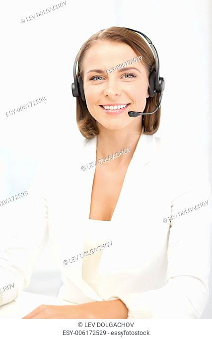 business, communication and call center concept - smiling female helpline operator with headphones in call center