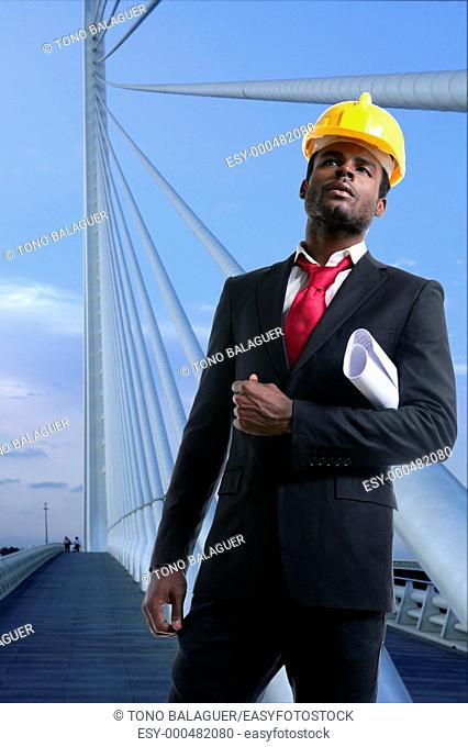 African american architect engineer with yellow hardhat and plans