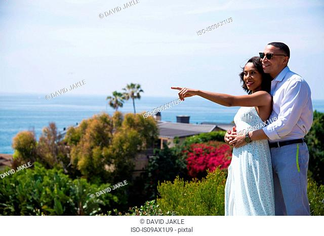 Honeymoon couple hugging and enjoying view near ocean, Los Angeles, California