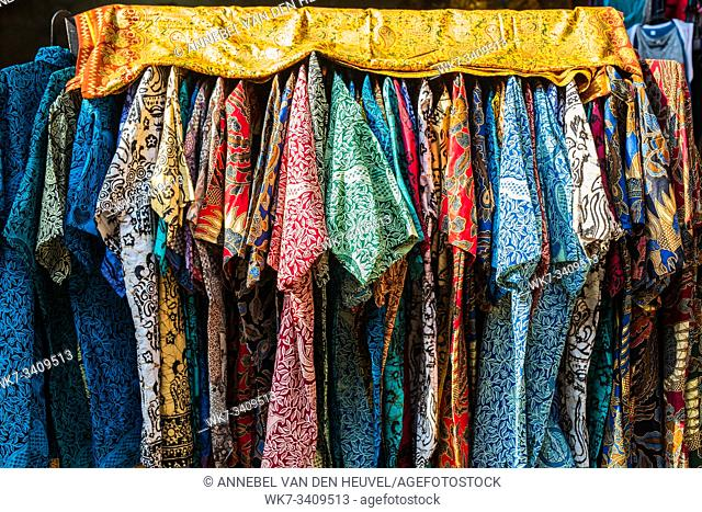 stack of traditional colourful sarong in a row on the market in Indonesia colorful