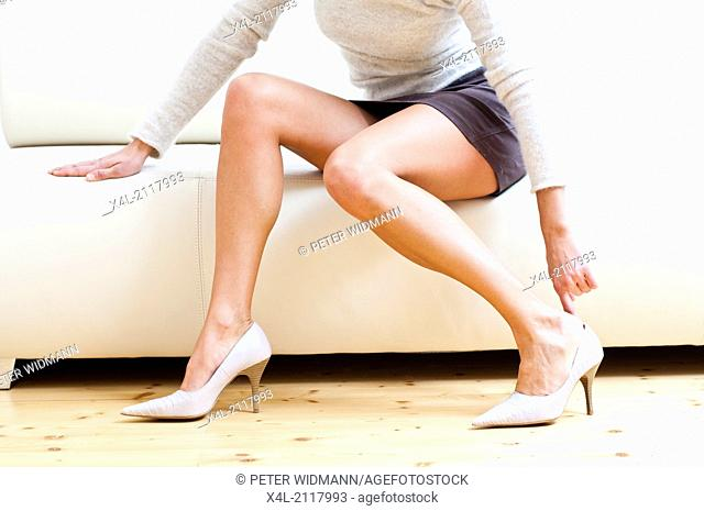 Long female legs with miniskirt and high heeled shoes (model-released)