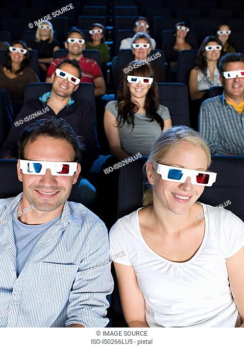 A cinema audience watching a 3d movie