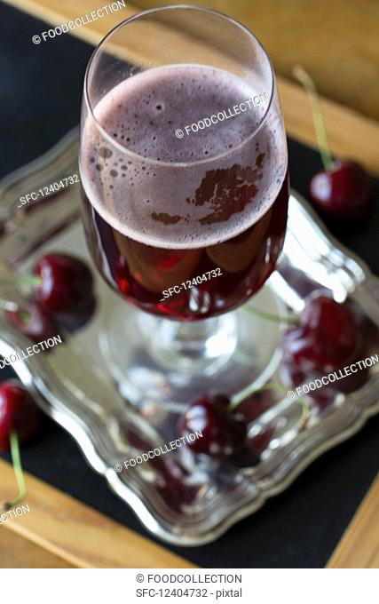 A glass of cherry beer