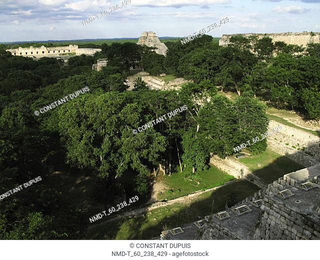 High angle view of the old ruins in a forest, Pyramid Of The Magician, Uxmal, Yucatan, Mexico
