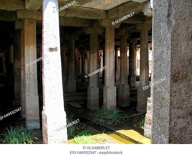 Beautiful columns architecture of ancient ruins of temple in Hampi, Karnataka, India
