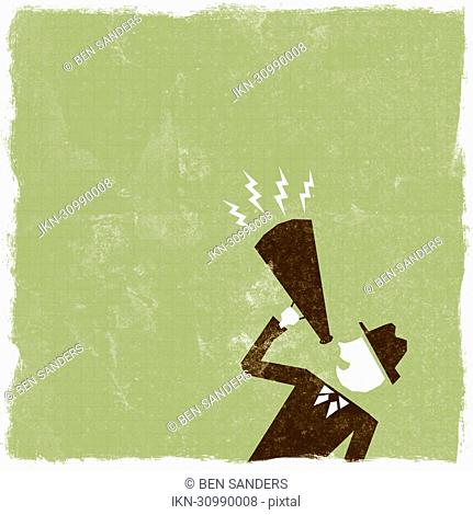 Businessman shouting in bullhorn