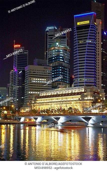 night skyline of singapore business district and marina bay  the building in the foreground is the fullerton hotel  asia