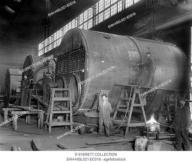 Steam ship boilers under construction in Wyandotte, Michigan in 1912. The massive coal fired boilers were 14' in diameter