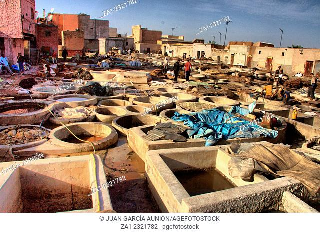 MARRAKESH: Unidentified people perform the work in tannery souk. Within moroccan artisanal economy leather is the countrys largest export