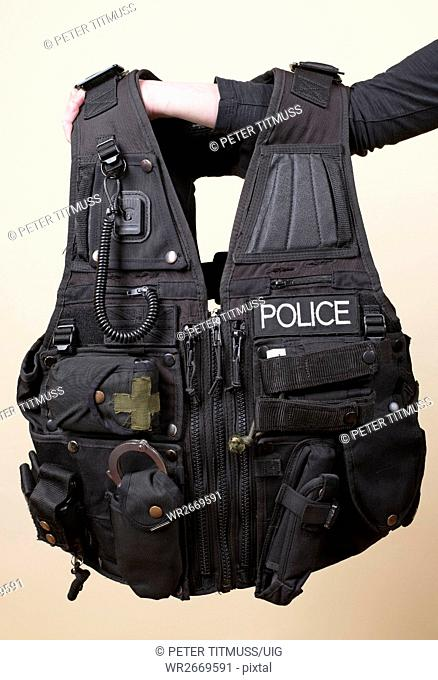 Person Holding Police Tactical Vest
