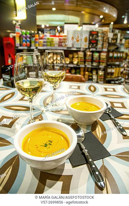 Pumpkin cream and two glasses of white wine. Madrid, Spain