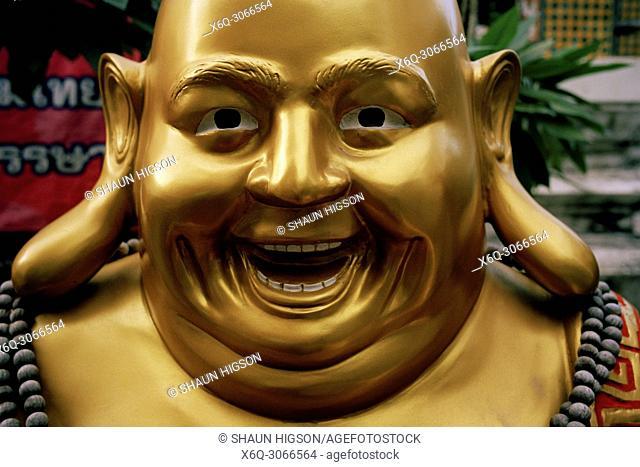Happy Buddha at Wat Arun Temple of Dawn in Bangko Yai Thonburi in Bangkok in Thailand in Southeast Asia Far East