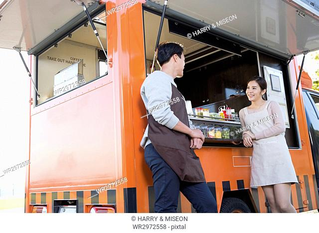 Smiling man and woman at food truck