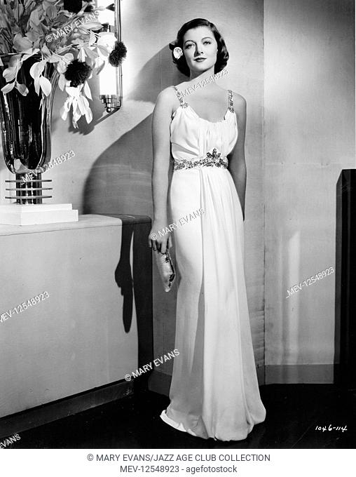 Myrna Loy in a Dolly Tree gown from Too Hot to Handle (MGM 1938), which was the one concession to glamour in the film. This cool, white, crepe column gown