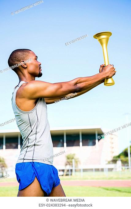 Athlete holding a fire torch