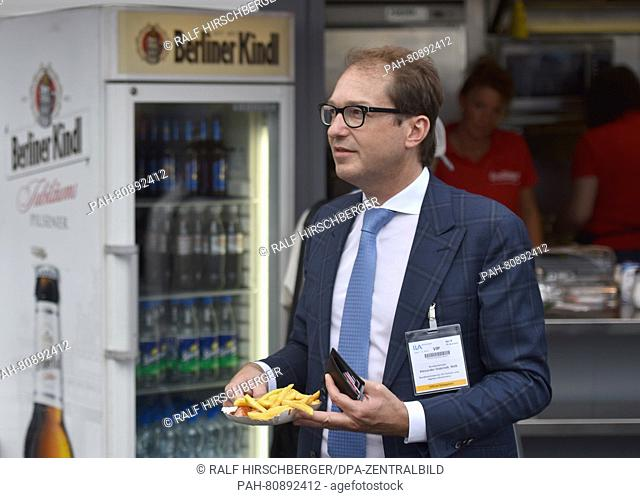 German Minister of Transport Alexander Dobrindt gets a currywurst at a sausage stand at the Berlin Air Show (ILA)in Schoenefeld, Germany, 02 June 2016