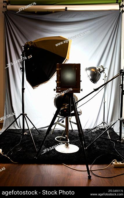 Lighting set in a studio with a large old wooden camera