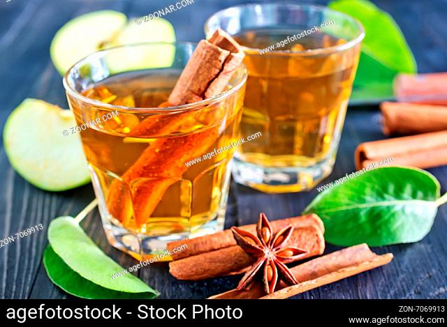 apple cider with cinnamon in the glass