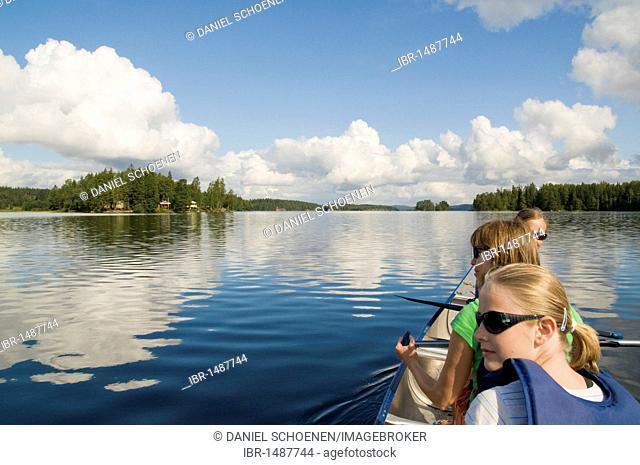 Family paddling in Sweden, Scandinavia, Europe