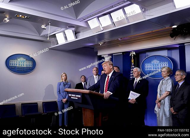 United States President Donald J. Trump, center, speaks during a Coronavirus Task Force news conference in the briefing room of the White House in Washington, D