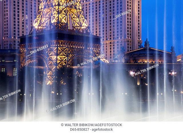 Paris-Las Vegas hotel and Casino along The Strip in the evening, through the Bellagio dancing fountains, Las Vegas, Nevada, USA