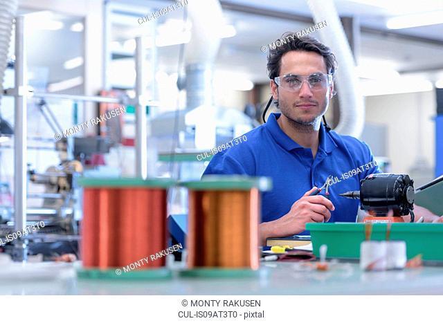 Portrait of male worker in electronics factory