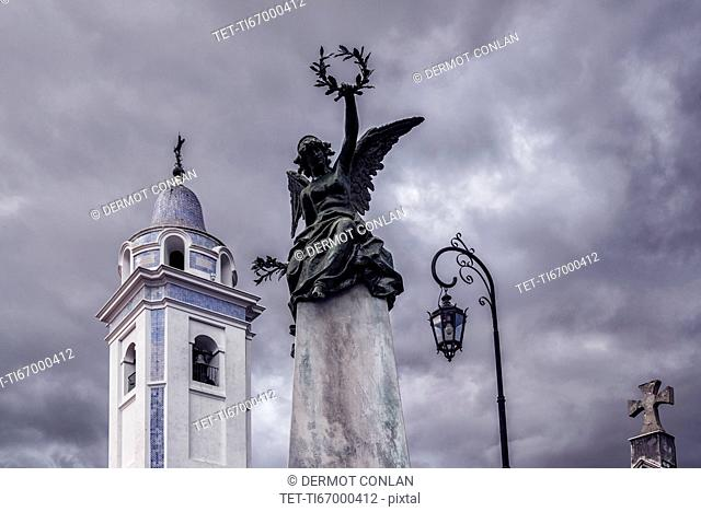 Statue and bell tower of Our Lady Del Pilar Church