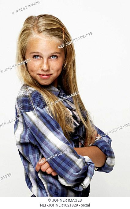 Girl posing with arms folded