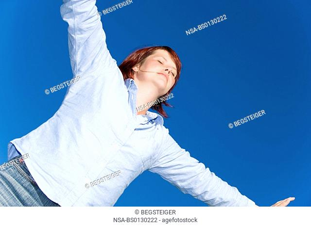 woman relaxing under free sky