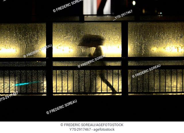 Silhouette of man holding umbrella, Tokyo, Japan,Asia