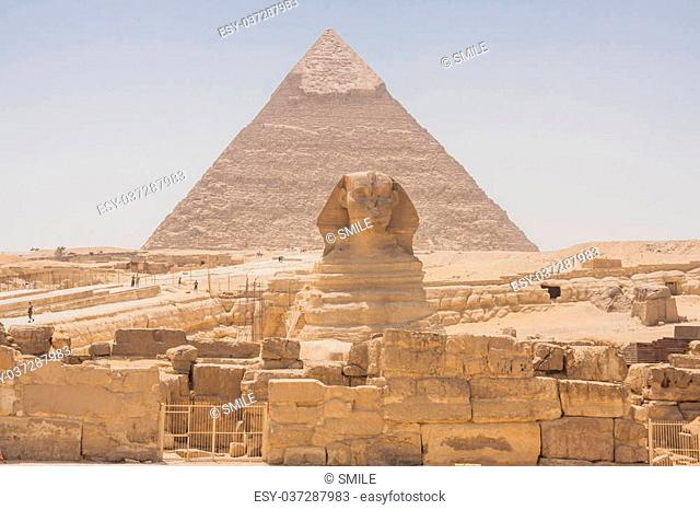 Great Sphinx of Giza with pyramides on the background