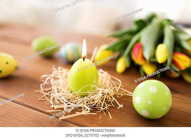 candle in shape of easter eggs and tulip flowers