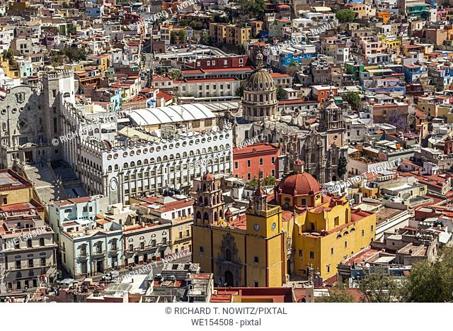 The brightly painted house, University and the Cathedral form colorful pattern in the historic center of Guanajuato, Mexico