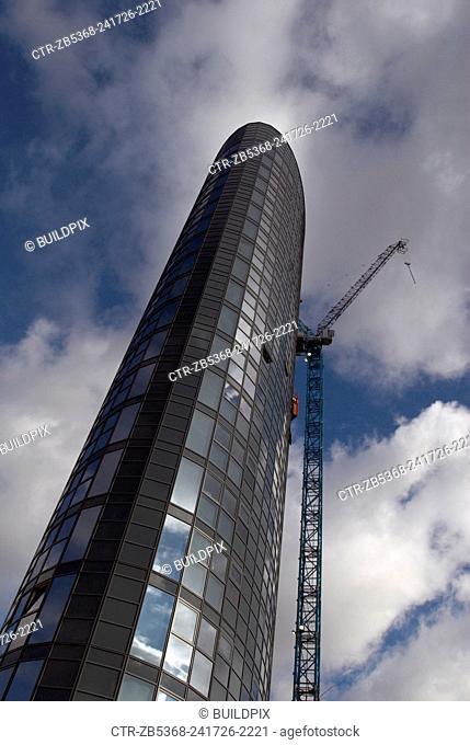 Tower crane next to Stratford Eye building under construction, East London, UK