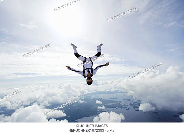 Skydiver, clouds in the background