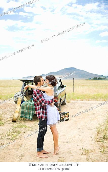 Loving couple on road trip