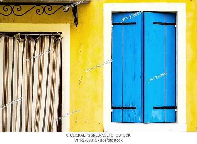 Burano, Venice, Veneto, North East Italy, Europe. Colored facade in Burano