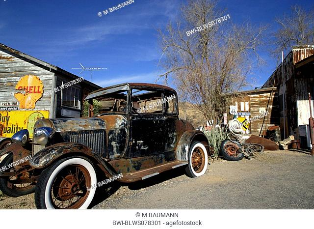 car wreck at an old fuel station, USA, California