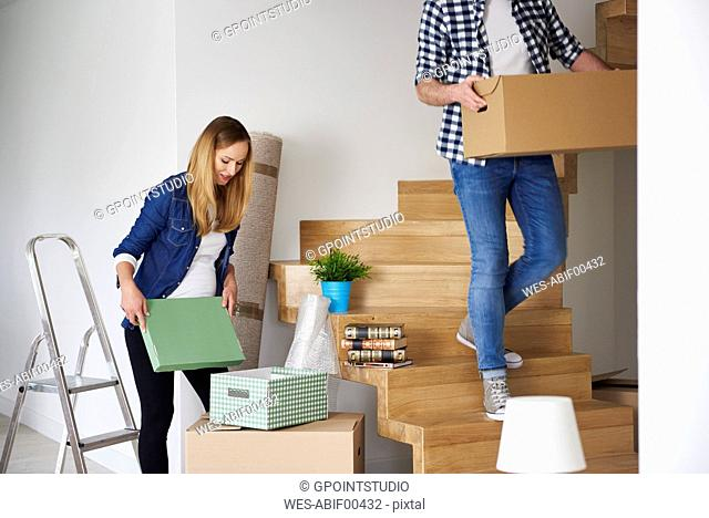 Couple moving house packing their belongings