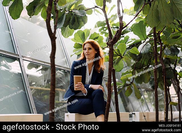 Businesswoman having a break in a modern office building