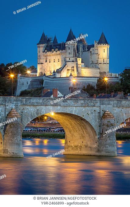 Twilight over Chateau Saumur (b. 12th century), Pont Cessart and River Loire, Maine-et-Loire, Centre, France