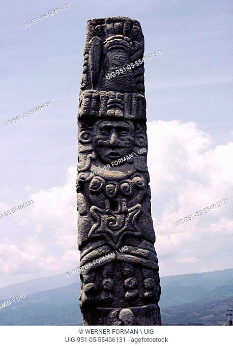 The upper section of a stele showing Quetzalcoatl wearing his traditional cone shaped hat, a necklace, earrings and, on his chest, the wind jewel