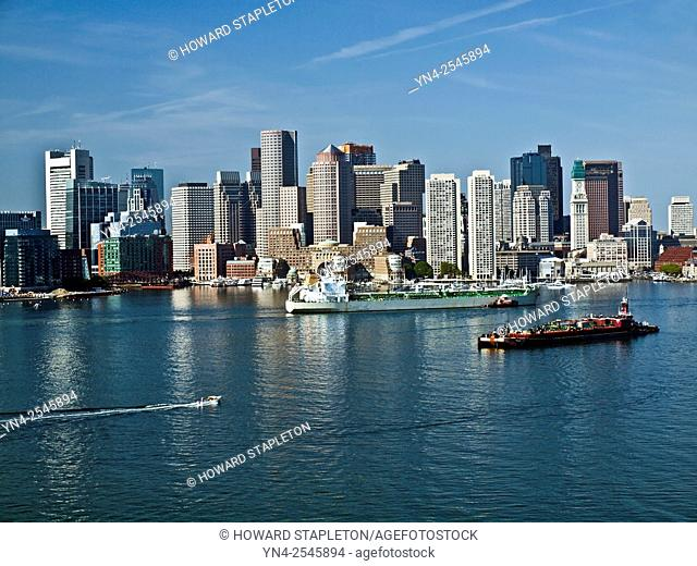 The oil tanker New England cruises into Boston harbor past downtown.
