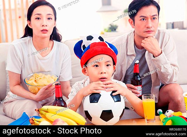 Happy three watch the game at home