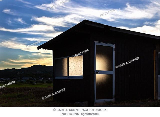 Dusk light and shed, Yufuin, Oita, Japan