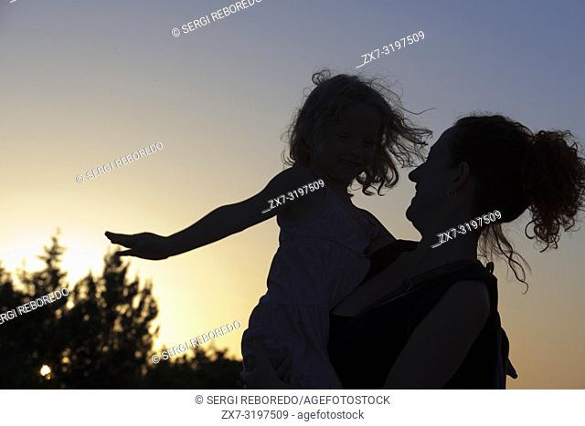 Backlighting. Mother with a child. Sunset. Pudent Lake. Formentera. Balearic Islands, Spain, Europe