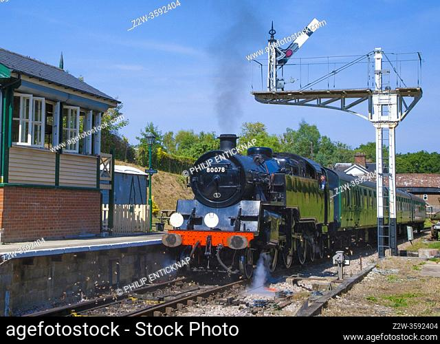 Class 4MT Standard Tank 80078 waits at Groombridge Station on the Spa Valley Railway , Kent