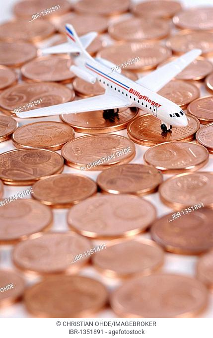 Miniature aircraft on cent coins, cheap airlines